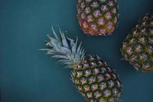 fruit flat-lay photography of three pineapples pineapple