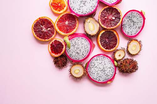 fruit flatlay photography of citrus and dragon pink