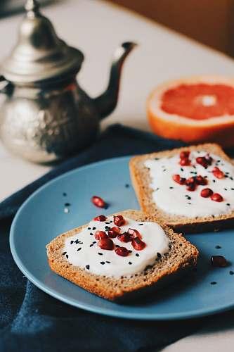 meal flatlay photography of spreaded bread beside teapot breakfast