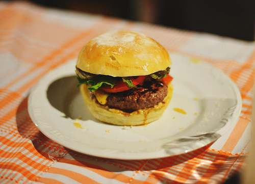 burger food photography of meat burger with tomatoes and lettuce homemade