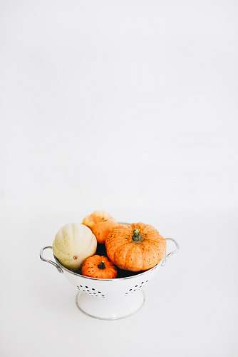vegetable four round orange squashes on colander fall