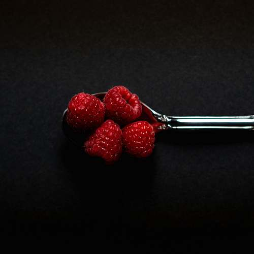 plant four Strawberry fruits on stainless steel spoon fruit
