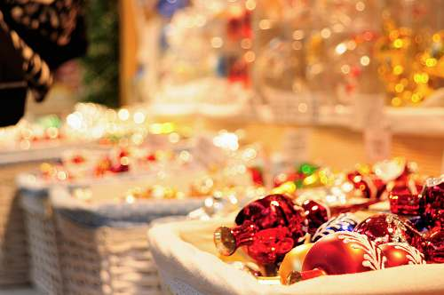 sweets four white wicker basket filled with Christmas decor lot selective focus photography confectionery