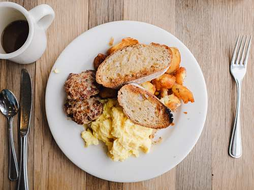 bread French bread and mashed potato on white ceramic plate toast