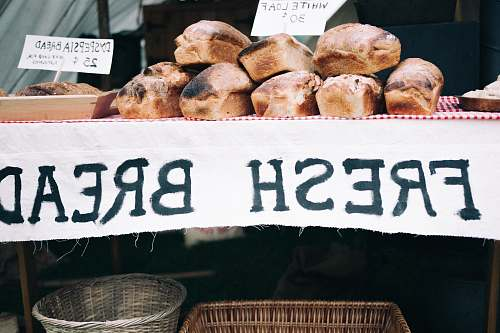 bread fresh bread on table during day time bakery