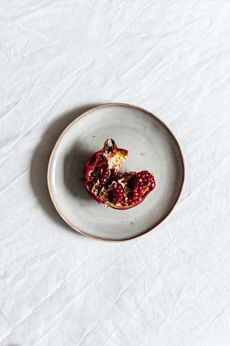 fruit fruit on white ceramic plate pomegranate