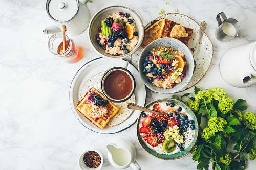 breakfast fruit salad on gray bowls brunch