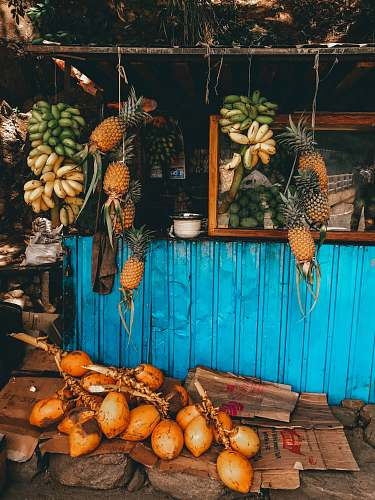 plant fruits hanged on string at stall during daytime fruit