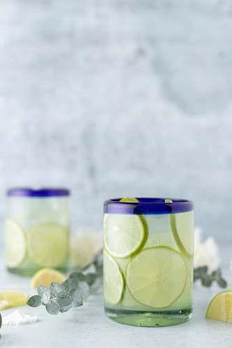 plant glass of lemon juice lime