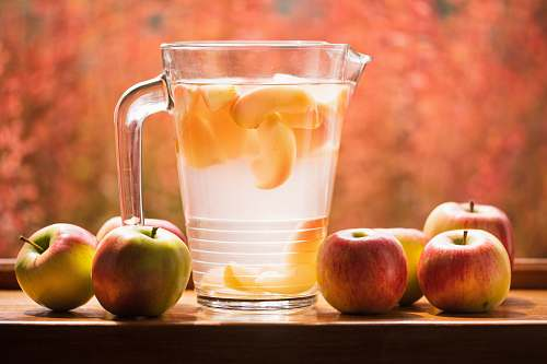 apple glass pitcher and apples on table produce