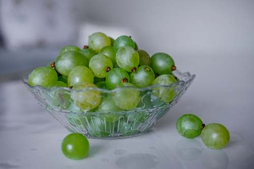 plant green grapes in clear glass bowl fruit