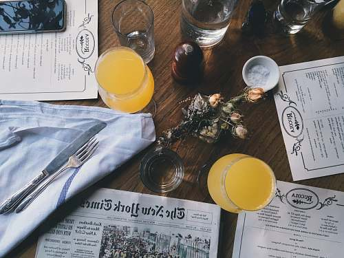 photo drink grey New York Time newspaper on table together with juice glasses restaurant free for commercial use images