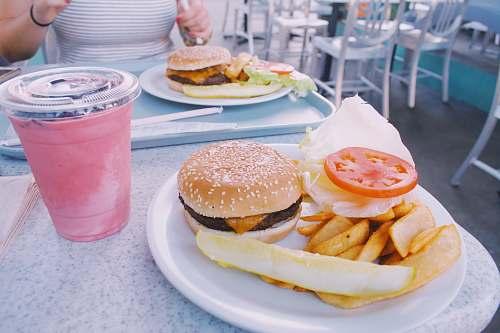 burger hamburger and potato fries meal on table chair