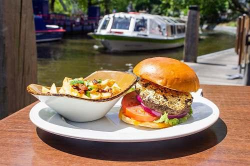 burger hamburger and salad on white tray boat