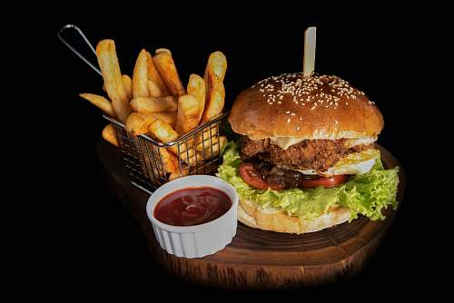 burger hamburger beside fries and ketchup fries