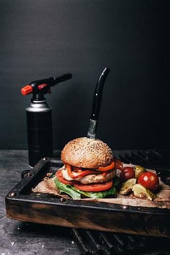 burger hamburger beside kitchen torch bread