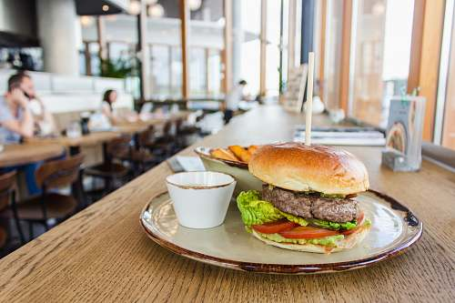 burger hamburger on round white ceramic plate furniture
