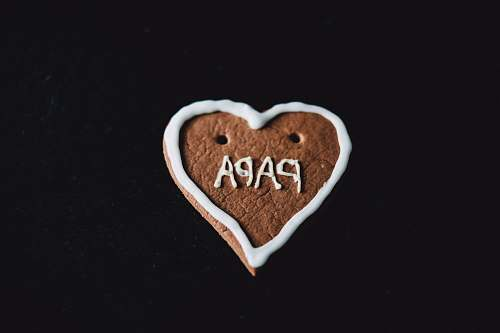 confectionery heart-shaped cookie with papa decoration sweets