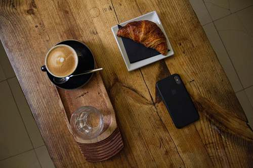 bread iPhone X on table croissant