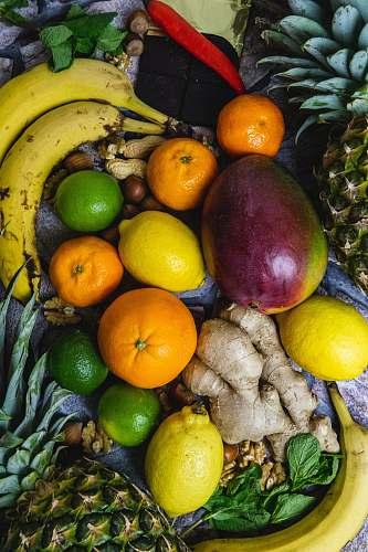fruit lemon, avocado, ginger, orange fruit, bananas and calamdin citrus fruit