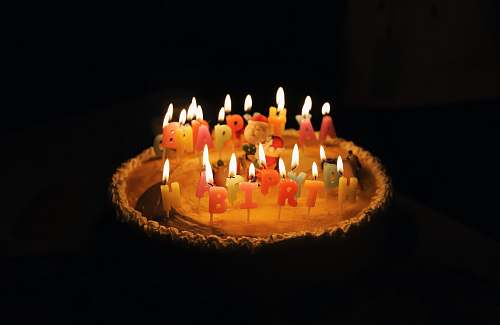 cake lighted assorted-color birthday candles in cake birthday cake