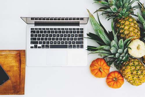 fruit MacBook Pro and assorted fruits flat lay photography pineapple