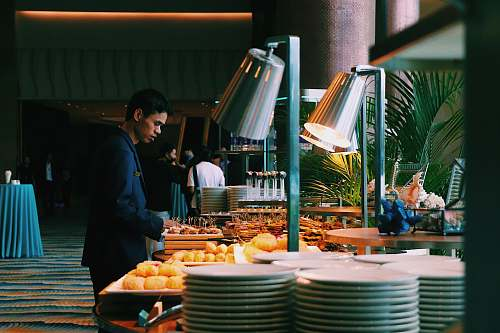 meal man pick some food at buffet table restaurant