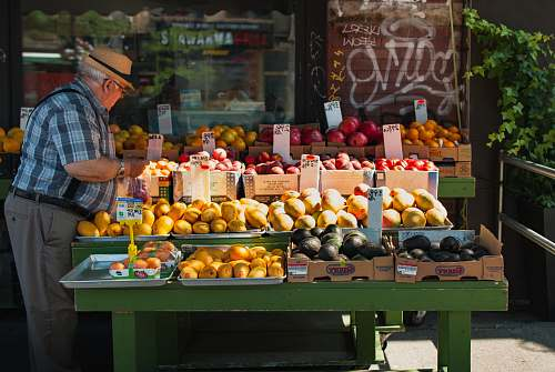 fruit man picking fruit from a fruit stand citrus fruit