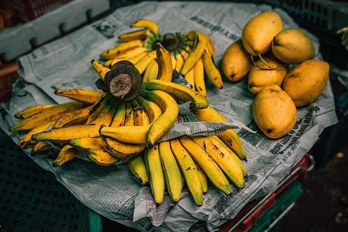 fruit mangoes and bananas on newspaper banana