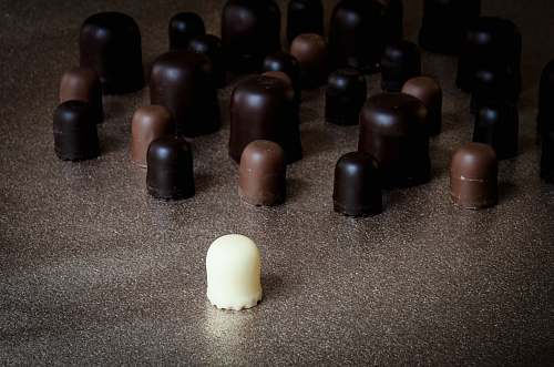 confectionery milk chocolate in front of scattered chocolates sweets