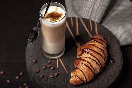 coffee milk in drinking glass neat break croissant