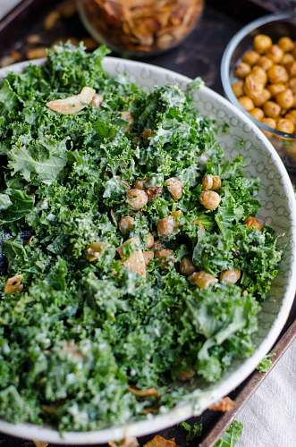 kale nuts and parsley in a bowl produce