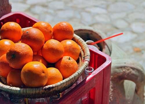 fruit orange fruit in brown basket orange