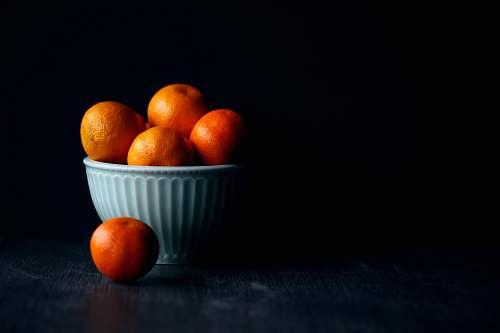 fruit orange fruit in white ceramic bowl plant