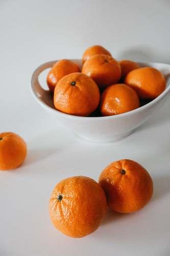 fruit orange fruits on white bowl plant