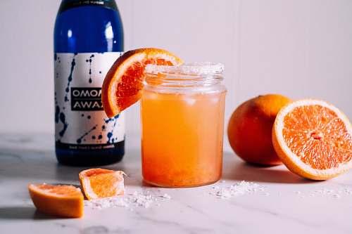 orange orange juice in clear glass mason jar citrus fruit