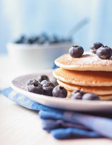 fruit pancake on plate with berries blueberry
