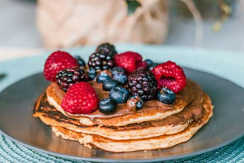 bread pancake with raspberries and blue berries toppings pancake