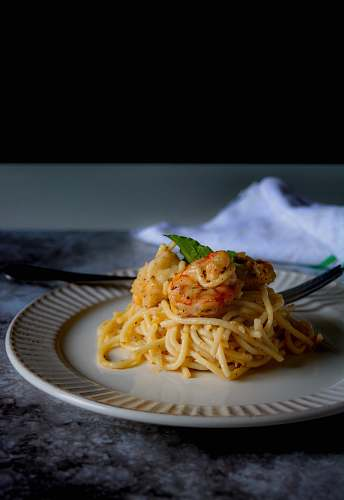 pasta pasta dish on white ceramic plate spaghetti