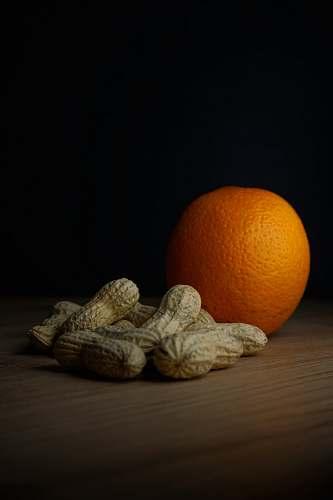 plant peanuts and orange fruit photograph orange