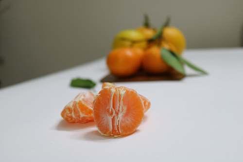 plant peeled orange fruit shallow focus photography citrus fruit