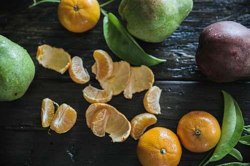 fruit peeled oranges on table surround with other fruits citrus fruit