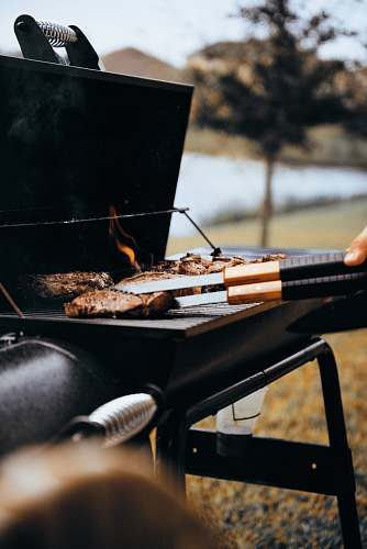bbq person grilling meat outdoors west melbourne