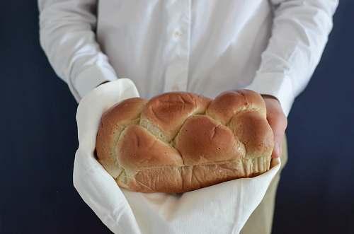 bread person holding baked bread bun