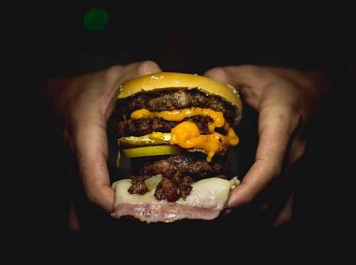 burger person holding hamburger dinner