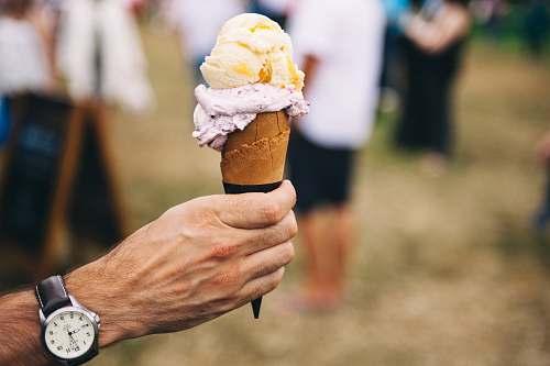 person person holding ice cream on cone ice cream
