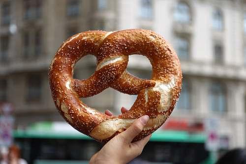 bread person holding pretzel pretzel