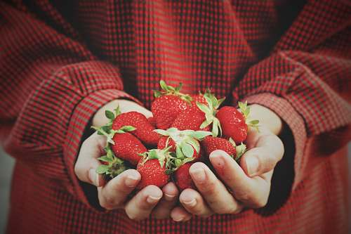 fruit person holding strawberries strawberry