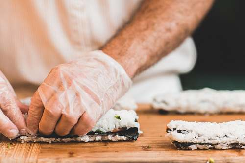 sushi person making sushi sushi roll