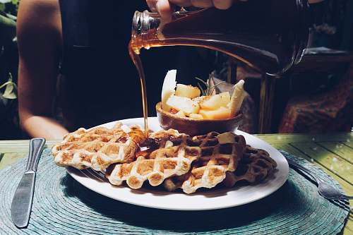waffle person poring syrup on waffles human